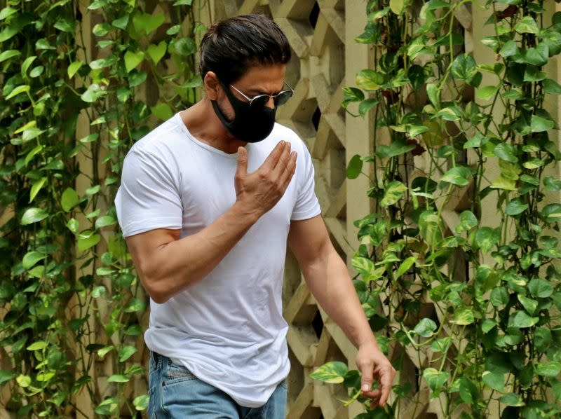 Actor Shah Rukh Khan arrives to pay his respect at the residence of Bollywood actor Dilip Kumar after he died in a hospital in Mumbai