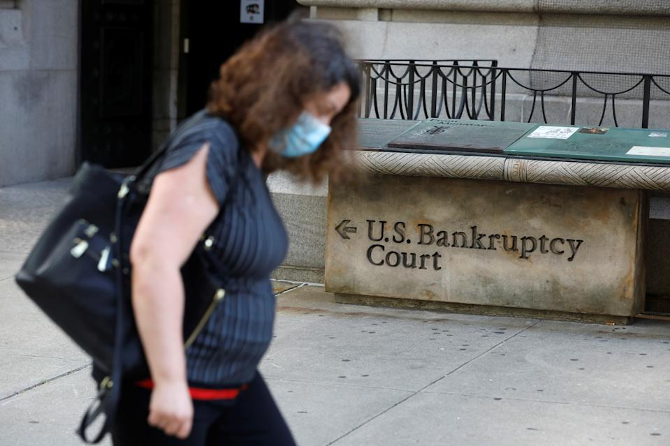 A person walks by the United States Bankruptcy Court for the Southern District of New York in Manhattan, New York City, U.S., August 24, 2020. REUTERS/Andrew Kelly