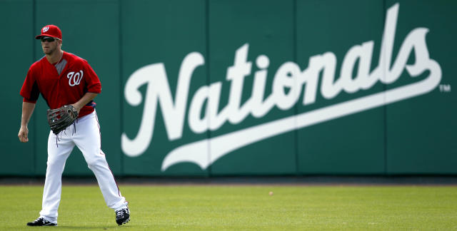 Washington Nationals prospect Bryce Harper stands in right field during spring training baseball, Thursday, March 1, 2012, in Viera, Fla. (AP Photo/Julio Cortez)