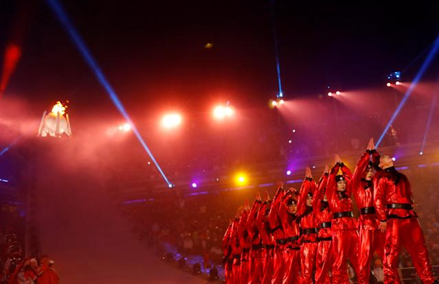<p>Artists perform during the opening ceremony. REUTERS/Kai Pfaffenbach </p>