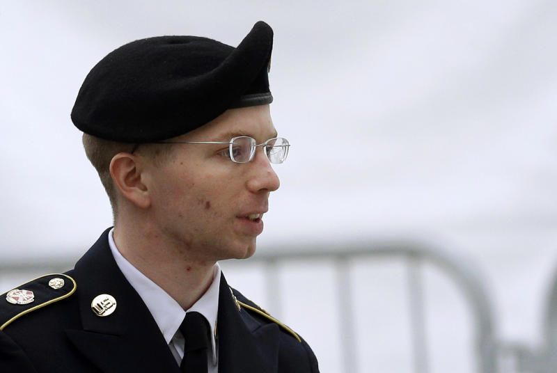 FILE - In this May 21, 2013 file photo, Army Pfc. Bradley Manning is escorted into a courthouse in Fort Meade, Md., before a pretrial military hearing. More than three years ago, Army Pfc. Bradley Manning was arrested in Iraq and charged in the biggest leak of classified information in U.S. history. About 20 Manning supporters demonstrated Monday morning in the rain outside the visitor gate at Fort Meade. (AP Photo/Patrick Semansky, File)
