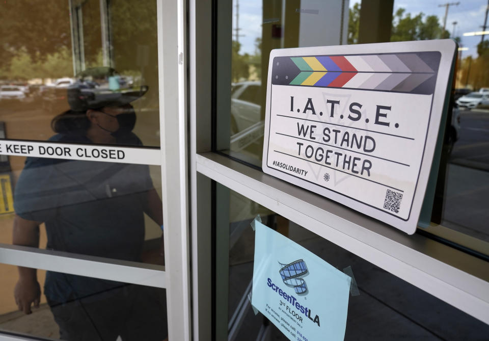 A man enters the union offices of The International Alliance of Theatrical Stage Employees (IATSE) Local 80, Monday, Oct. 4, 2021, in Burbank, Calif. The IATSE overwhelmingly voted to authorize a strike for the first time in its 128-year history. (AP Photo/Chris Pizzello)