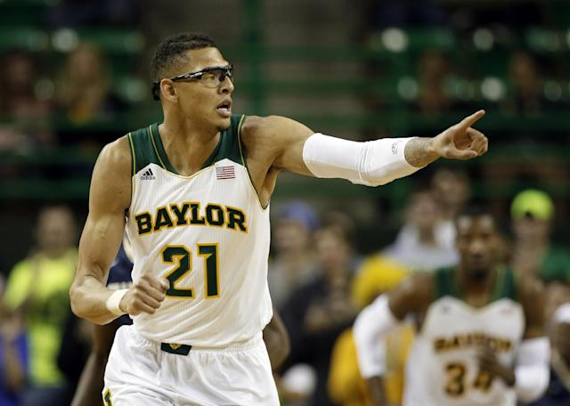 Baylor center Isaiah Austin (21) celebrates a basket as he runs up court during an NCAA college basketball game against Charleston Southern, Wednesday, Nov. 20, 2013, in Waco, Texas. (AP Photo/Tony Gutierrez)