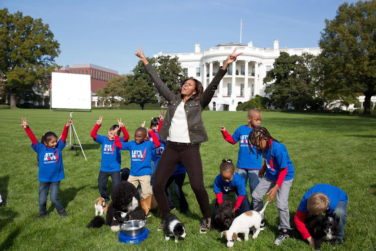 Oct. 28, 2013 'Amanda Lucidon made this photograph of the First Lady as she participated in a filming for the Animal Planet Puppy Bowl on the South Lawn of the White House.' (Official White House Photo by Amanda Lucidon) This official White House photograph is being made available only for publication by news organizations and/or for personal use printing by the subject(s) of the photograph. The photograph may not be manipulated in any way and may not be used in commercial or political materials, advertisements, emails, products, promotions that in any way suggests approval or endorsement of the President, the First Family, or the White House. (Photo by Amanda Lucidon/The White House/Corbis via Getty Images)