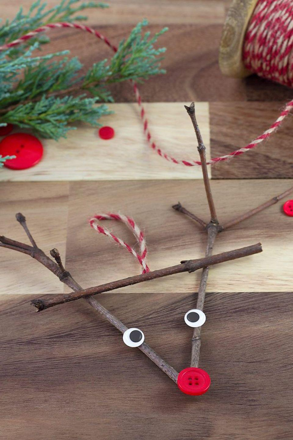 "<p>This reindeer ornament will go down in (craft) history.</p><p><strong>Get the tutorial at <a href=""https://www.firefliesandmudpies.com/twig-reindeer-ornaments/"" rel=""nofollow noopener"" target=""_blank"" data-ylk=""slk:Fireflies and Mud Pies"" class=""link rapid-noclick-resp"">Fireflies and Mud Pies</a>.</strong></p>"