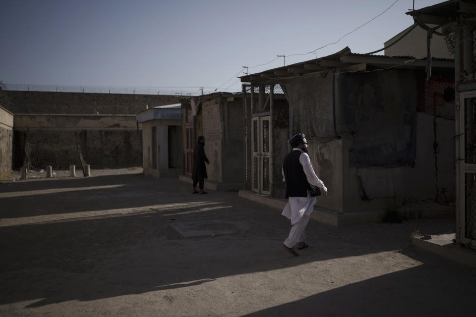 Taliban fighters walk through an empty area of the Pul-e-Charkhi prison in Kabul, Afghanistan, Monday, Sept. 13, 2021. Pul-e-Charkhi was previously the main government prison for holding captured Taliban and was long notorious for abuses, poor conditions and severe overcrowding with thousands of prisoners. Now after their takeover of the country, the Taliban control it and are getting it back up and running, current holding around 60 people, mainly drug addicts and accused criminals. (AP Photo/Felipe Dana)