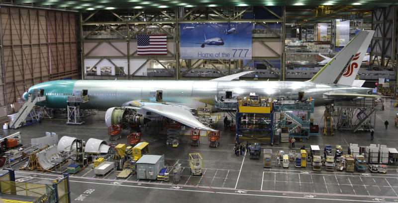 In this June 2, 2011 photo, the Boeing Co. 777 airplane assembly line is shown, in Everett, Wash.  Boeing Co. announced the first big-ticket order in its rivalry with Airbus at the start of the Paris Air Show on Monday, June 20, saying Qatar Airways has ordered six 777 jets in a $1.7 billion deal. (AP Photo/Ted S. Warren)