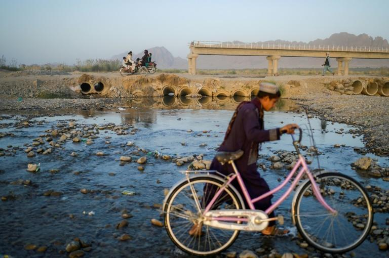 Last year the bridge over the river was destroyed by bloody clashes between the Taliban and government forces (AFP/Bulent KILIC)