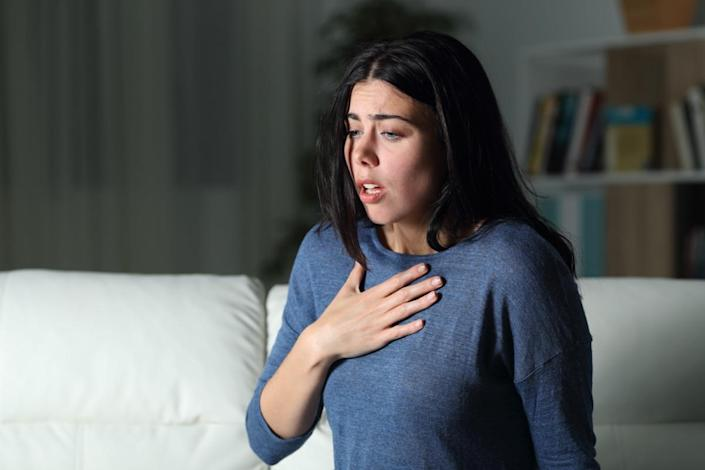 Woman suffering an anxiety attack alone in the night