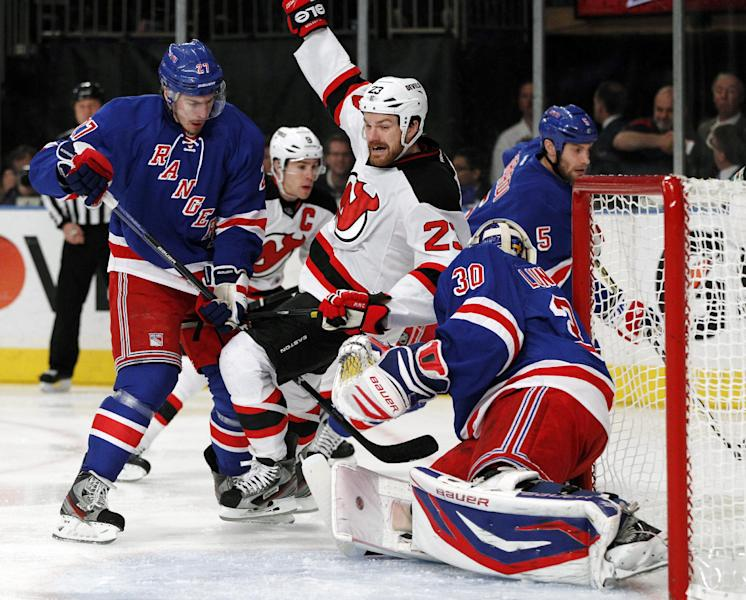 New York Rangers' Ryan McDonagh (27) defends as New Jersey Devils right wing David Clarkson (23) falls into the crease near Rangers goalie Henrik Lundqvist (30) during the first period of Game 1 of their NHL hockey Stanley Cup Eastern Conference final playoff series at New York's Madison Square Garden, Monday, May 14, 2012. (AP Photo/Kathy Willens)
