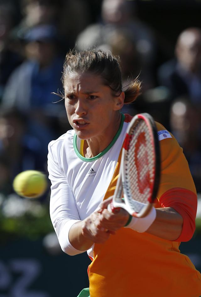 Germany's Andrea Petkovic returns the ball during the quarterfinal match of the French Open tennis tournament against Italy's Sara Errani at the Roland Garros stadium, in Paris, France, Wednesday, June 4, 2014. Petkovic won in two sets 6-2, 6-2. (AP Photo/David Vincent)