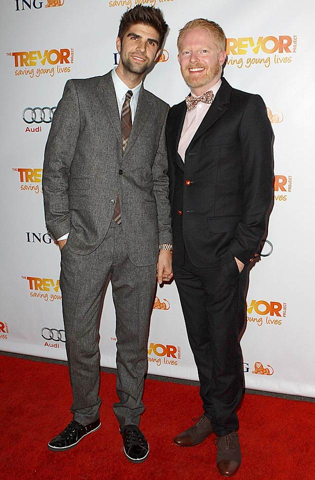 """Modern Family"" star Jesse Tyler Ferguson (right) was all smiles as he held hands with beau Justin Mikita on the red carpet. (12/4/2011)"