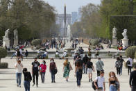 FILE - In this April 1, 2021, file photo, people wear face mask as they walk in a path of the Tuileries garden in Paris. European countries scrambled Monday, April 5 to tamp down a surge in COVID-19 cases and ramp up vaccinations, hoping to spare hospitals from becoming overwhelmed by the pandemic's latest deadly wave of infections. (AP Photo/Thibault Camus, File)
