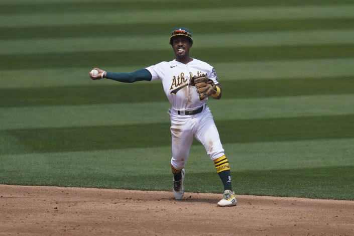 Oakland Athletics second baseman Tony Kemp throws out Houston Astros' Carlos Correa at first base during the third inning of a baseball game in Oakland, Calif., Saturday, April 3, 2021. (AP Photo/Jeff Chiu)