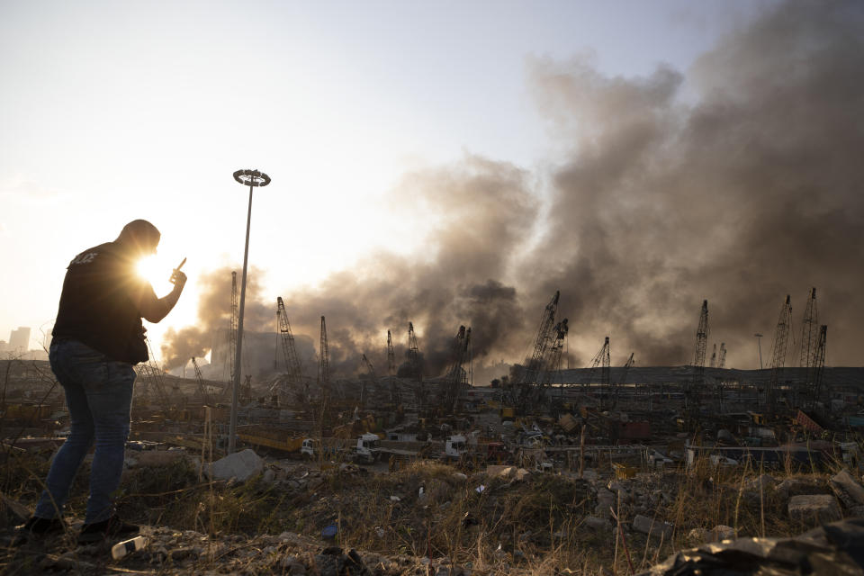 Aftermath of a massive explosion is seen in in Beirut, Lebanon, Tuesday, Aug. 4, 2020. Massive explosions rocked downtown Beirut on Tuesday, flattening much of the port, damaging buildings and blowing out windows and doors as a giant mushroom cloud rose above the capital. Witnesses saw many people injured by flying glass and debris. (AP Photo/Hassan Ammar)