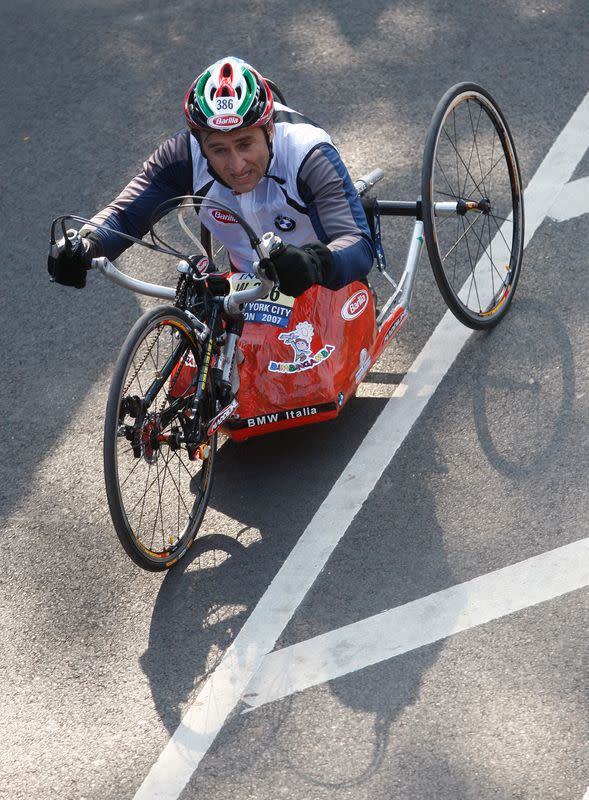 Italian Race car driver Alex Zanardi crosses the finish line in the Handcycle Division during the 2007 ING New York City Marathon in New York