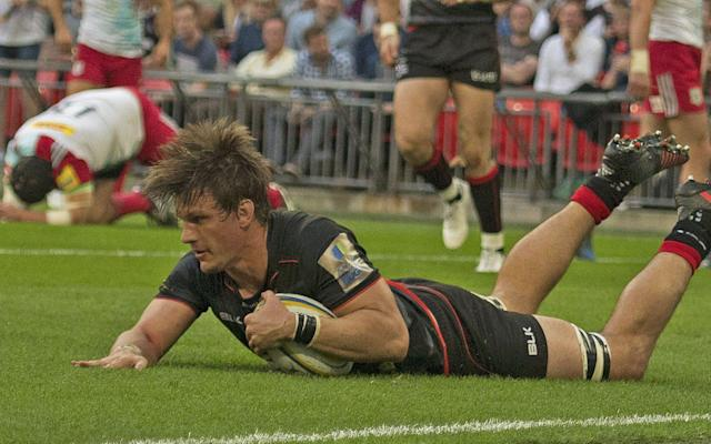 <span>Michael Rhodes scores for Saracens</span> <span>Credit: REX FEATURES </span>