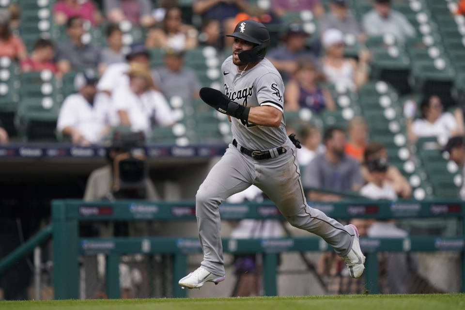 Chicago White Sox's Danny Mendick runs home to score during the fifth inning of a baseball game against the Detroit Tigers, Saturday, June 12, 2021, in Detroit. (AP Photo/Carlos Osorio)
