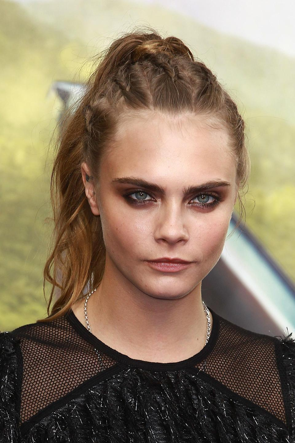 <p>Who said a ponytail has to boring? Delevingne definitely didn't when she added five symmetrical braids into her hair before pulling it all into a high-ish pony with the ends just slightly waved. </p>