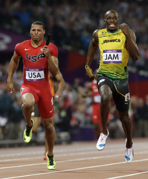 Jamaica's Usain Bolt leads United States' Ryan Bailey to win the men's 4 x 100-meter relay final during the athletics in the Olympic Park during the 2012 Summer Olympics, Saturday, Aug. 11, 2012, in London. Jamaica set a new world record with a time of 36.84 seconds.(AP Photo/Anja Niedringhaus)