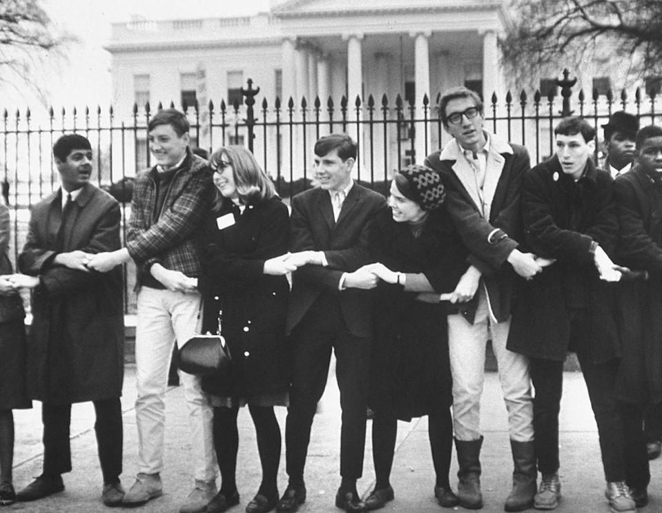 <p>Protestors linked arms in front of the White House at a civil rights rally. </p>