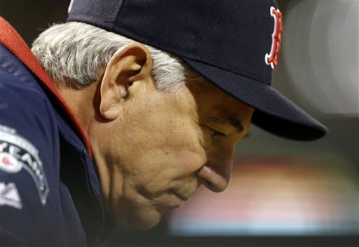 Boston Red Sox manager Bobby Valentine looks on from the dugout in the second inning of a baseball game against the Baltimore Orioles in Baltimore, Friday, Sept. 28, 2012. (AP Photo/Patrick Semansky)