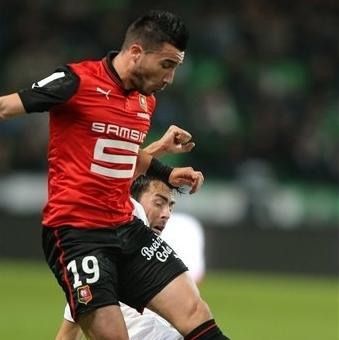 French forward Romain Alessandrini of Rennes is tackled by Lille's defender Marko Basa of Montenegro during their french League One soccer match in Rennes, western France, Friday, Sept. 28, 2012. (AP Photo/David Vincent)
