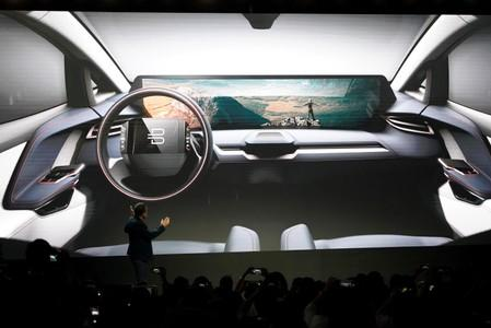FILE PHOTO: Chairman of the Board, CEO and co-founder of Future Mobility, Carsten Breitfeld, speaks in front of a screen showing an image of a new Byton car at a press conference in Shanghai