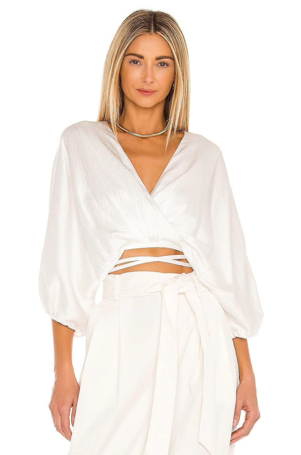 <p>We love this <span>Aiifos Cecile Top</span> ($325) paired with white bottoms for a chic tonal look.</p>