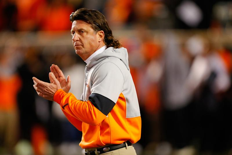 STILLWATER, OK - NOVEMBER 30: Head coach Mike Gundy of the Oklahoma State Cowboys encourages his team before Bedlam against of the Oklahoma Sooners on November 30, 2019 at Boone Pickens Stadium in Stillwater, Oklahoma. OU won 34-16. (Photo by Brian Bahr/Getty Images)