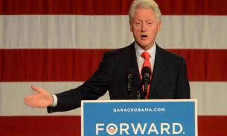Former President Bill Clinton speaks at a campaign stop at the University of New Hampshire, on Oct. 3.