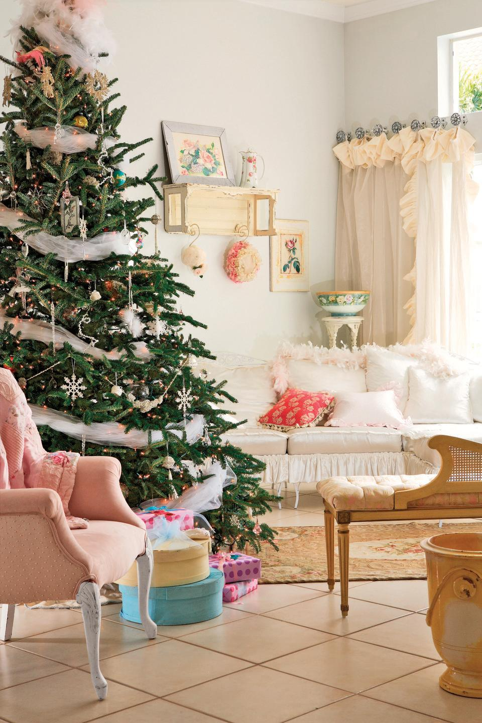 """<p>A wrap of shimmery mesh tulle ribbon gives your Christmas tree a flirty, feminine touch. The look pairs perfectly with beaded snowflakes and pink and blue glass ornaments. To get a similar feel without some of the pouf, use shimmery organza ribbon in a two or three-inch width. </p><p><a class=""""link rapid-noclick-resp"""" href=""""https://www.amazon.com/Shimmer-Tulle-Ribbon-Rolls-Glimmer/dp/B018672YNO/ref=sr_1_7?tag=syn-yahoo-20&ascsubtag=%5Bartid%7C10050.g.28703522%5Bsrc%7Cyahoo-us"""" rel=""""nofollow noopener"""" target=""""_blank"""" data-ylk=""""slk:SHOP TULLE RIBBON"""">SHOP TULLE RIBBON</a></p>"""