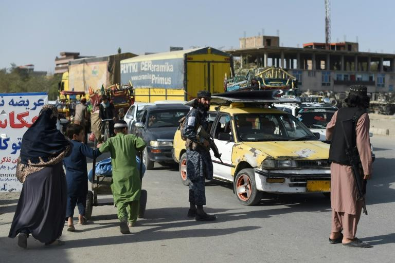 For the new Taliban policemen, it can be challenging to go from a life immersed in extreme violence to maintaining law and order (AFP/WAKIL KOHSAR)