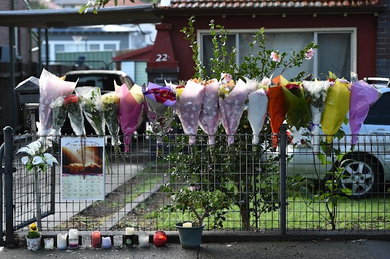 Bouquets are seen in front of the home of the parents of executed Australian drug convict Andrew Chan in Sydney on May 2, 2015 (AFP Photo/Saeed Khan)