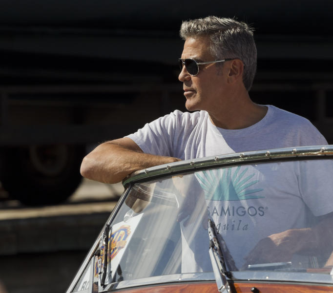 Actor George Clooney arrives on a boat at the 70th edition of the Venice Film Festival in Venice, Italy, Tuesday, Aug. 27, 2013. (AP Photo/Domenico Stinellis)