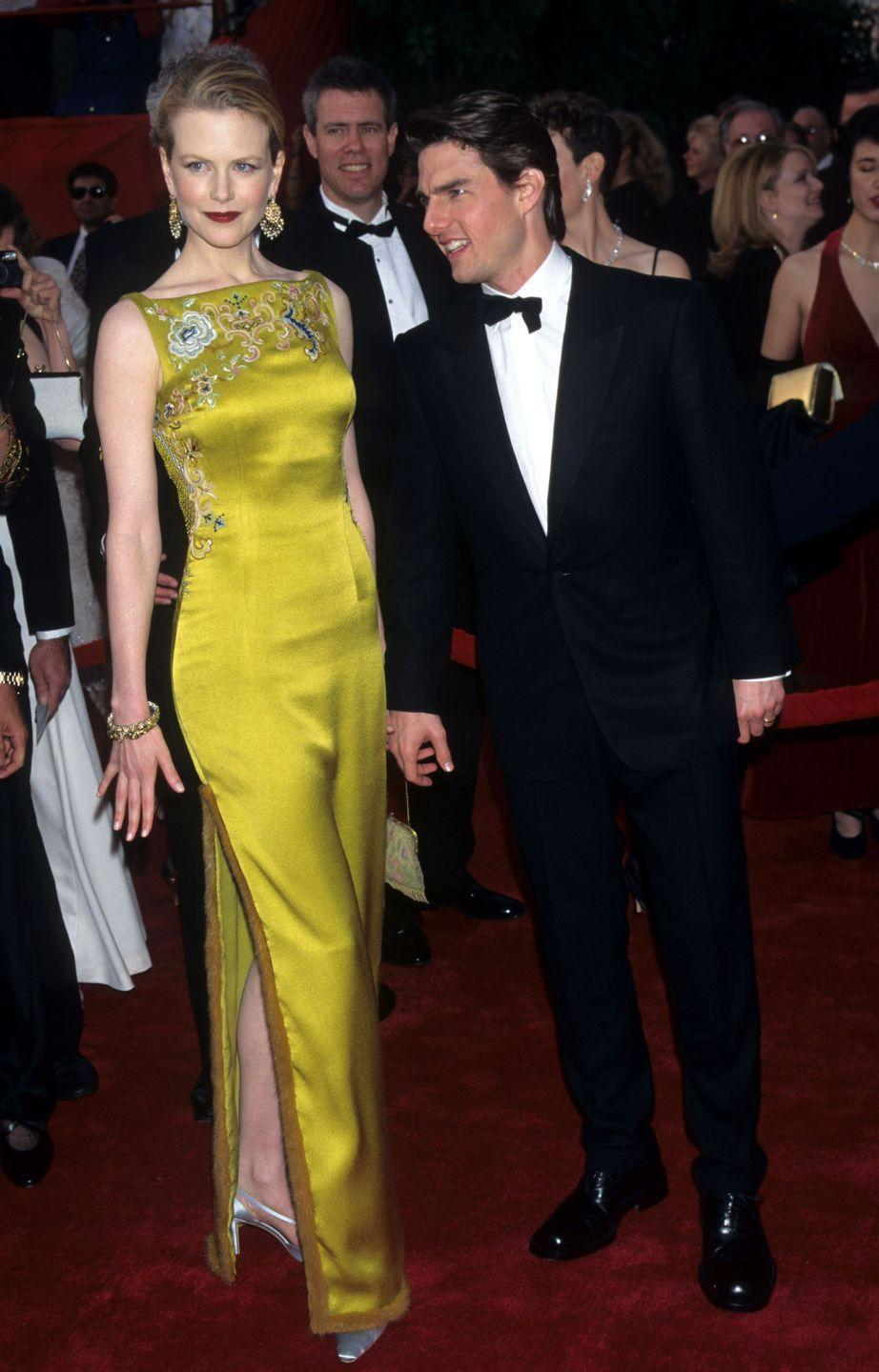 <p>Leave it to Nicole Kidman to upstage then husband Tom Cruise in a silky chartreuse John Galliano Dior dress paired with an adorable mini bag. So on trend! </p>
