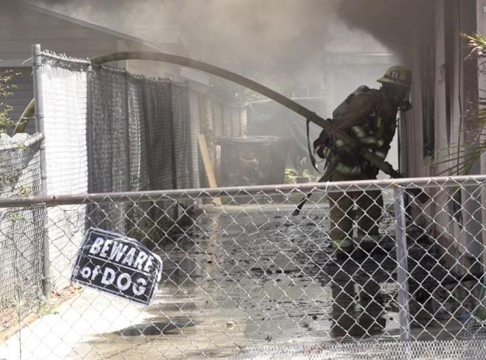 Three firefighters were injured by a downed power line while battling a four-alarm blaze in the city of Orange today. The fire broke out about 12:40 p.m. at 211 S. Earlham St., according to a fire department dispatcher. It started as a vehicle fire between two homes that spread to multiple residences, the dispatcher said.