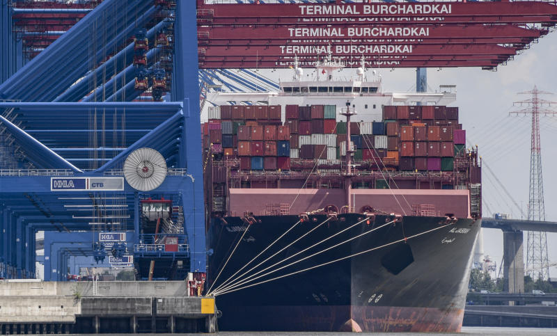 """15 June 2020, Hamburg: The container freighter """"Al Jasrah"""" is unloaded at Burchardkai terminal. Hamburg's exports fell sharply in the first three months of the year. Compared with the same period last year, exports fell by 14.1 per cent to 10.5 billion euros, the Statistics Office North announced in the Hanseatic City on 16 June 2020. Photo: Axel Heimken/dpa (Photo by Axel Heimken/picture alliance via Getty Images)"""
