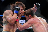 Brendan Loughnane, right, and Tyler Diamond trade punches during a Professional Fighters League mixed martial arts bout in Atlantic City, N.J., Thursday, June 10, 2021. (AP Photo/Matt Rourke)
