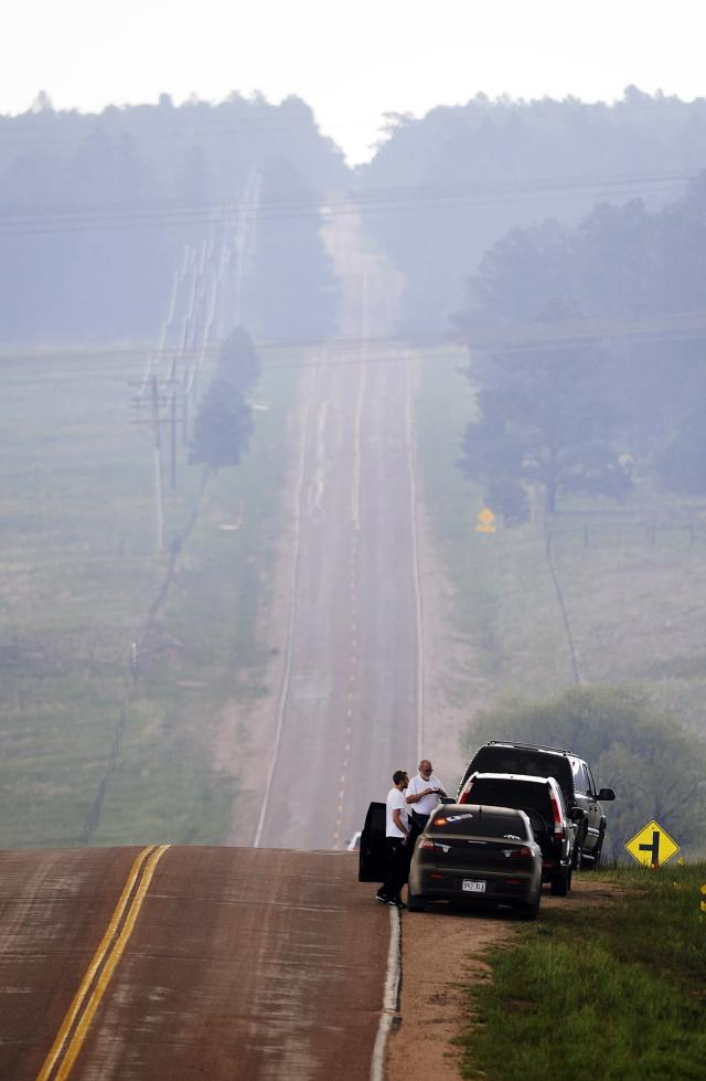 COLORADO SPRINGS, CO - JUNE 12: People stop by the side of a road to watch the Black Forest Fire June 12, 2013 near Colorado Springs, Colorado. The fire has reportedly burned 80 to 100 homes and has charred at least 8,000 acres. (Photo by Chris Schneider/Getty Images)