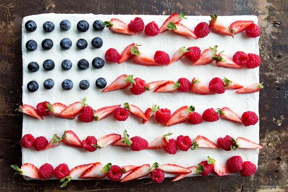 """<p>We pledge allegiance to the honey whipped cream on this American flag cake.</p><p><em><a href=""""https://www.delish.com/cooking/recipe-ideas/recipes/a42975/flag-cake/"""" rel=""""nofollow noopener"""" target=""""_blank"""" data-ylk=""""slk:Get the recipe from Delish »"""" class=""""link rapid-noclick-resp"""">Get the recipe from Delish »</a></em></p>"""