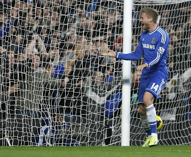 Chelsea's Andre Schuerrle celebrates scoring a goal during the English Premier League soccer match between Chelsea and Manchester City at Stamford Bridge Stadium in London, Sunday, Oct. 27, 2013. (AP Photo/Kirsty Wigglesworth)
