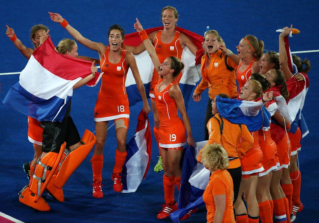 LONDON, ENGLAND - AUGUST 10:  Team Netherlands celebrate their 2-0 victory over team Argentina after the Women's Hockey gold medal match on Day 14 of the London 2012 Olympic Games at Hockey Centre on August 10, 2012 in London, England.  (Photo by Daniel Berehulak/Getty Images)