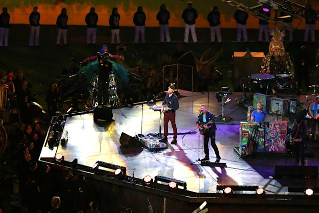 LONDON, ENGLAND - SEPTEMBER 09: (L-R) Will Champion, Chris Martin, Jonny Buckland and Guy Berryman of Coldplay perform during the closing ceremony on day 11 of the London 2012 Paralympic Games at Olympic Stadium on September 9, 2012 in London, England. (Photo by Dean Mouhtaropoulos/Getty Images)