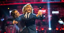 """<p>This year's <em>Strictly Come Dancing </em>was a huge ratings success and also scandal plagued from the get-go. The first scandal to hit was a surprise kiss between Seann Walsh and married Katya Jones. The <em>Strictly </em>couple were caught kisssing outside a Marylebone, London pub and <a rel=""""nofollow"""" href=""""https://uk.news.yahoo.com/strictly-seann-katya-apologise-one-194709380.html"""" data-ylk=""""slk:both went on to apologise for their 'one-off mistake;outcm:mb_qualified_link;_E:mb_qualified_link;ct:story;"""" class=""""link rapid-noclick-resp yahoo-link"""">both went on to apologise for their 'one-off mistake</a>.' While Seann Walsh was swiftly dumped by <a rel=""""nofollow"""" href=""""https://uk.news.yahoo.com/rebecca-humphries-reveals-shocked-strictly-kissing-scandal-120114031.html?bcmt=1"""" data-ylk=""""slk:his actress girlfriend Rebecca Humphries;outcm:mb_qualified_link;_E:mb_qualified_link;ct:story;"""" class=""""link rapid-noclick-resp yahoo-link"""">his actress girlfriend Rebecca Humphries</a>, <em>Strictly </em>pros Katya Jones and Neil Jones remain married. </p>"""