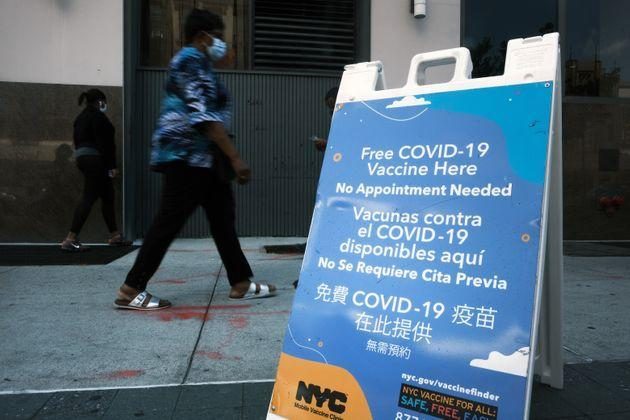 A city-operated mobile pharmacy advertises the COVID-19 vaccine in New York's Brooklyn neighborhood on July 30. Mayor Bill de Blasio has announced that the city will require all city workers to be vaccinated or tested weekly for COVID-19 and the city will now pay any individual $100 to get the shot. (Photo: Spencer Platt via Getty Images)
