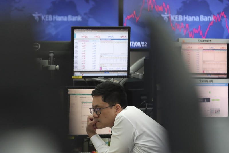 A currency trader watches monitors at the foreign exchange dealing room of the KEB Hana Bank headquarters in Seoul, South Korea, Monday, Oct. 7, 2019. Asian shares were mixed Monday, following a healthy report on U.S. jobs, while investors cautiously awaited the upcoming trade talks between the U.S. and China. (AP Photo/Ahn Young-joon)