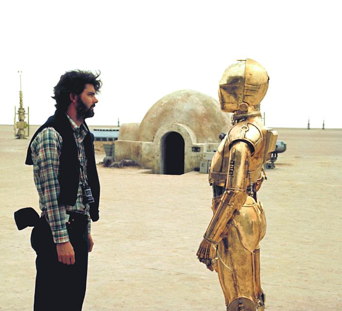 """<h1 class=""""title"""">On the set of Star Wars: Episode IV - A New Hope</h1> <div class=""""caption""""> George Lucas (left), directing <em>Star Wars: Episode IV—A New Hope.</em> The Star Wars saga was extended with a prequel trilogy in the late '90s and early '00s, a continuation with three more films released in the 2010s, and more in the works today. </div> <cite class=""""credit"""">Photo: Sunset Boulevard/Corbis via Getty Images</cite>"""