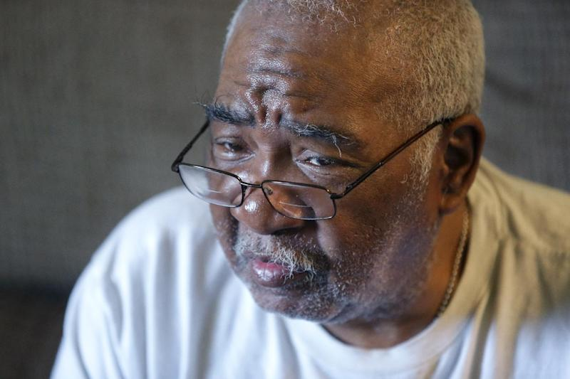 In an April 26, 2013 photo, Lester Stiggers is interviewed by the Associated Press in Warren, Mich. Since he fled prison in 1970, the convicted killer has spent most of his life a free man in the Detroit area, thanks to a progressive governor who refused to send him back to Arkansas. Arkansas prison officials say they didn't know a 63-year-old fugitive was sick when asked Michigan this year to return Stiggers. But Department of Correction spokeswoman Shea Wilson told The Associated Press on Wednesday, May 8, 2013 that it's not the agency's role to make judgments about whether Stiggers should be brought back to the Arkansas prison system he fled in 1970. (AP Photo/Carlos Osorio)
