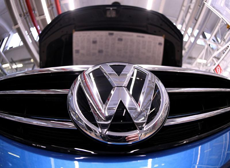 FILE PHOTO: A Volkswagen logo is pictured in a production line at the Volkswagen plant in Wolfsburg, Germany March 1, 2019. REUTERS/Fabian Bimmer
